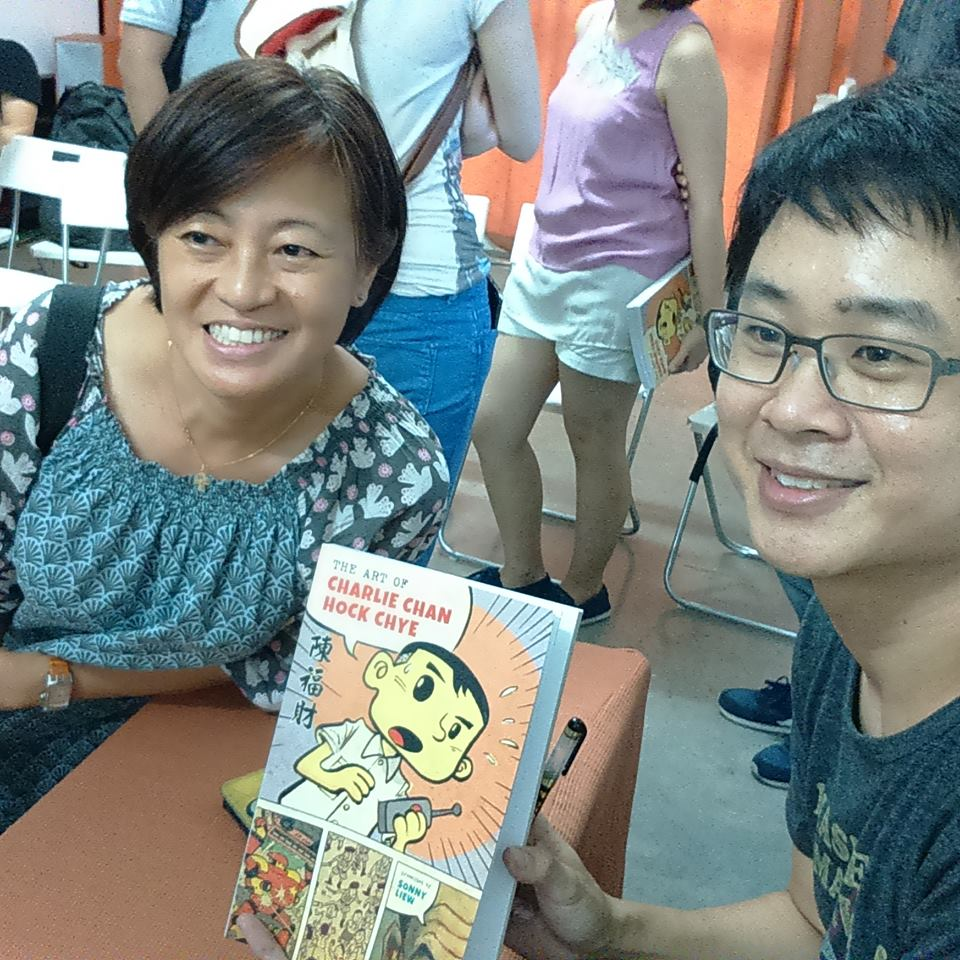 "Sonny Liew signs a copy of ""Charlie Chan"" (image - The Agora Facebook page)"