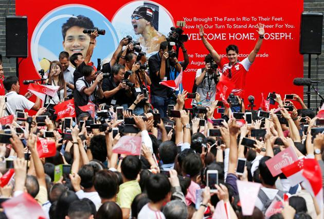 Euphoric celebration by Singaporeans (photo by Edgar Su Reuters)