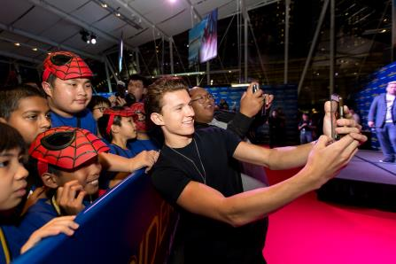 Spider man thrill for dyslexia kids the independent ryan ho yan xing fourth from left and his friends at a meet and greet session with tom holland lead actor of spider man homecoming photo marina bay m4hsunfo