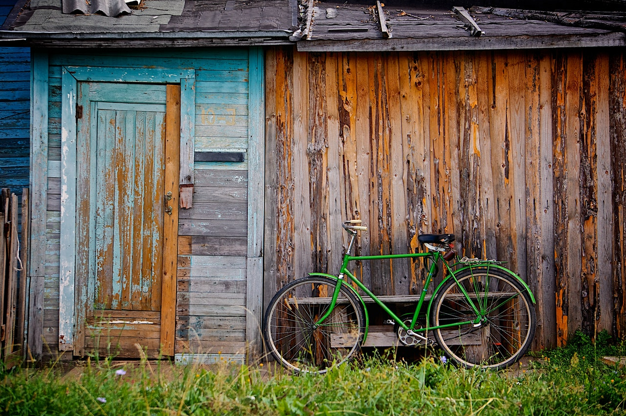 Image of a bicycle against a wall in a village