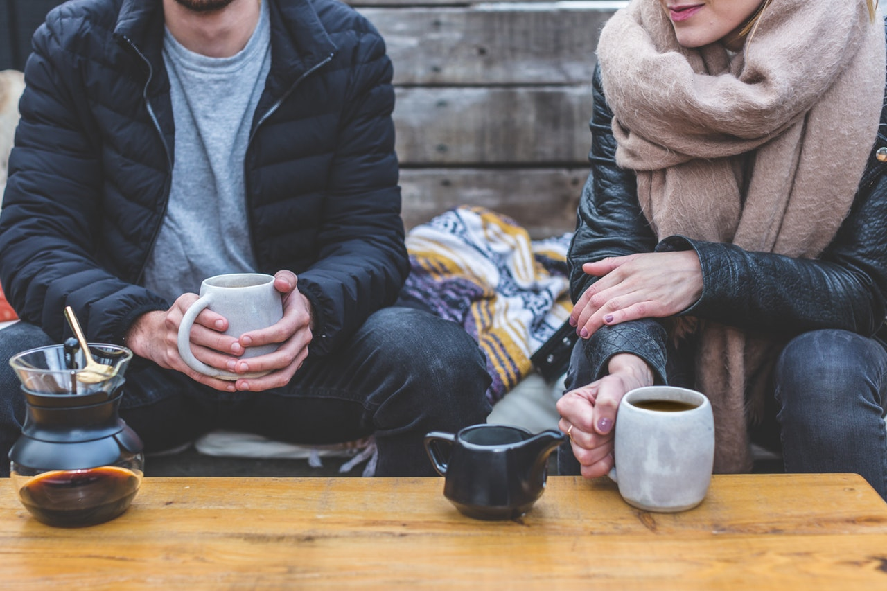 Image of a couple talking over a coffee