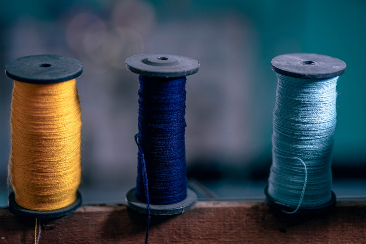 Image of a few spools of colourful thread