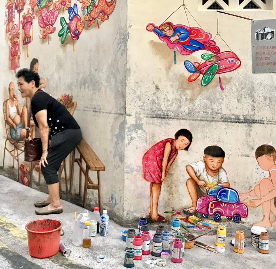 Local Artist Draws Crowds With Mid Autumn Festival Murals In